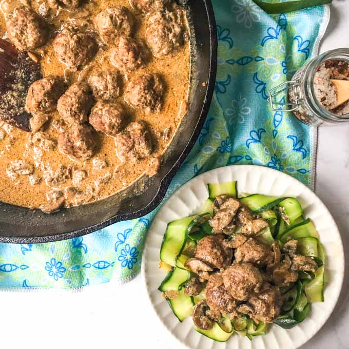 This low carb meatball stroganoff is the perfect way to top zucchini noodles. Creamy mushrooms sauce over beefy meatballs, you can even eat these as is or as an appetizer.
