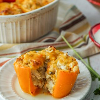 These cheesy chicken enchilada stuffed peppers make a delicious and easy low carbdinner that your family will love. They are a gluten free and fun way to get your Mexican food fix.