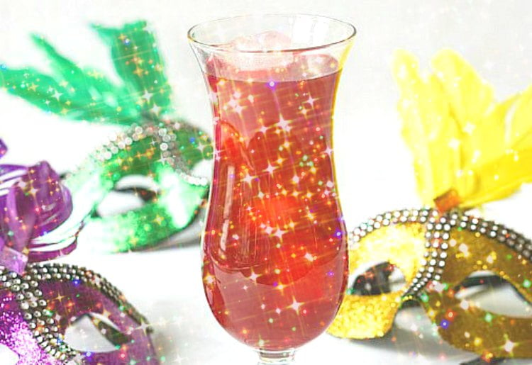 glittery pic of low carb hurricane drink with Mardi Gras masks around