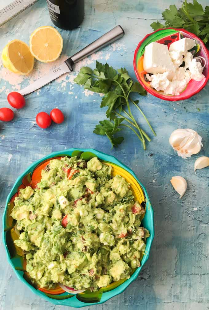This chunky greek guacamole is a great low carb dip to take to a party or just add to your next Mexican feast. Briny olive, salty cheese, sweet tomatoes all wrapped up in creamy avocados. One serving is just 3.6g net carbs.