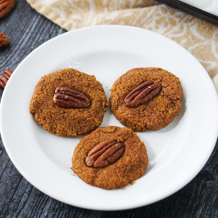 white plate with 3 pecan pumpkin keto cookies