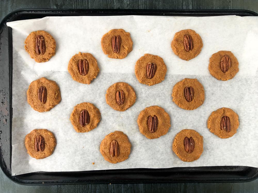 unbaked pecan pumpkin cookies on a cookie sheet