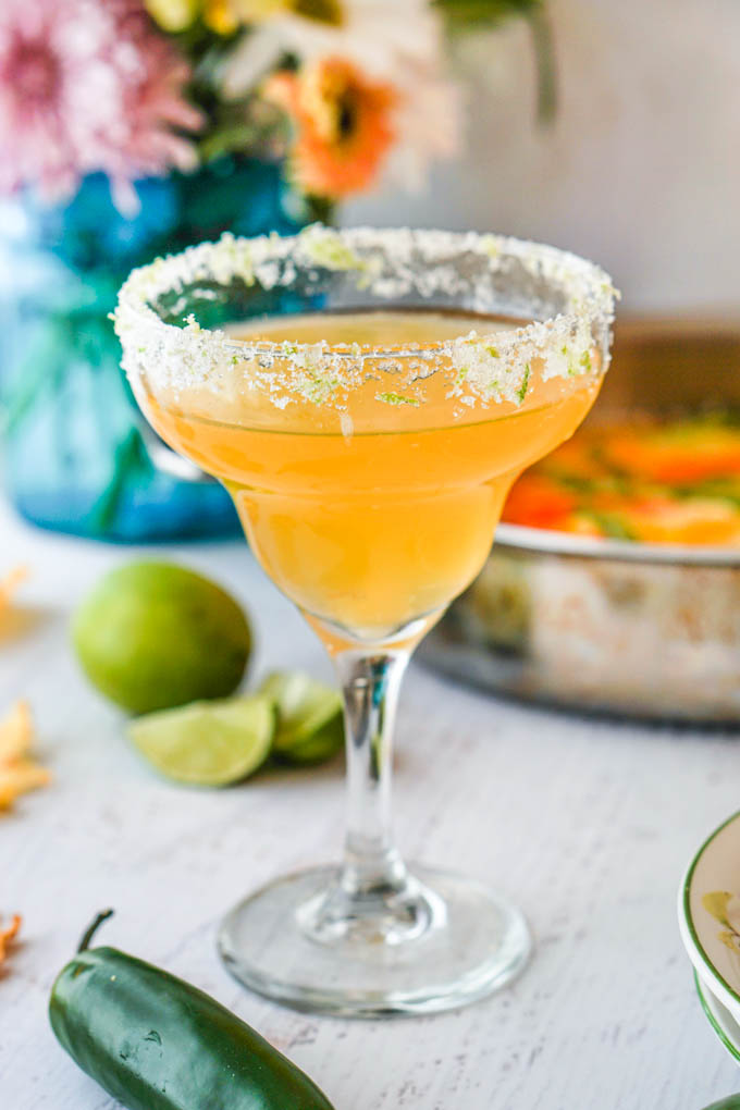 This spicy pineapple margarita is a festive, low carb drink that would be perfect for your next brunch or to pamper your mom on Mother's Day. Spicy infused tequila with sweet pineapple and tart lime make for a tasty drink.