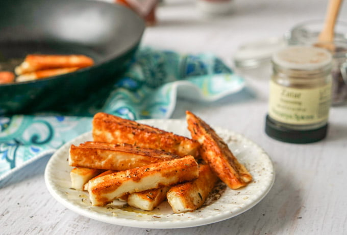 These za'atar halloumi cheese fries are a delicious low carb snack. Salty, briny halloumi cheese is simply pan fried and seasoned the bit of Middle Eastern za'atar spice. Only a few minutes to make, you will be crazy for this fried cheese snack.