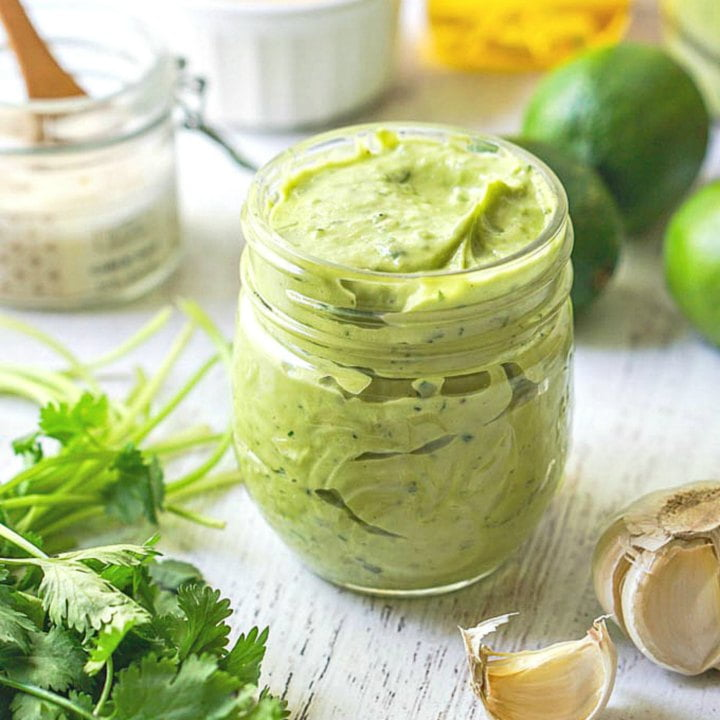 creamy avocado lime dressing in a jar