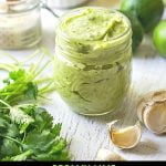 jar of creamy avocado dressing with text overlay