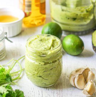 creamy avocado lime dressing in a jar