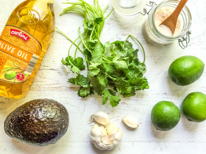 olive oil, cilantro, avocados, garlic, limes and salt for avocado dressing