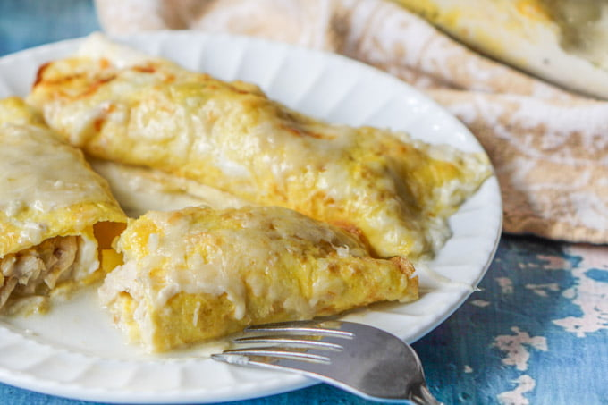 closeup of low carb chicken crepes with cream sauce and fork