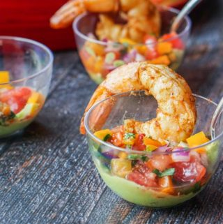 This Mexican shrimp cocktail is the perfect low carb appetizer for Cinco de Mayo! Each cup is filled with a creamy avocado dip, refreshing pico de gallo and 2 large spicy shrimp. Each serving has only 2.0g net carbs.