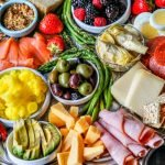 cheese platter full of low carb foods for a party platter with text