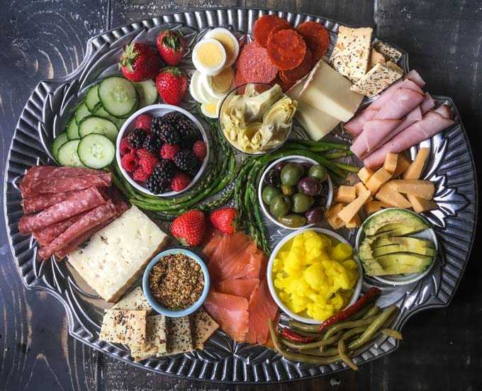 For a delicious low carb dinner you can put together in minutes, try this low carb cheese platter. Filled with tasty low carb foods, you can grab a glass of wine and talk about your day over this assortment of goodies.