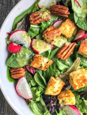 If you are missing those tasty, crunchy bits of bread on your salad, try these seasoned garlic keto croutons! It only takes 4 ingredients and these low carb croutons are full of flavor.