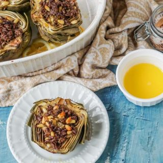 These meat stuffed artichokes are a delicious low carb dinner. The meat stuffing has mediterranean flavors of cinnamon and lemon with crunchy pine nuts. Enjoy artichokes in season with this easy dinner.