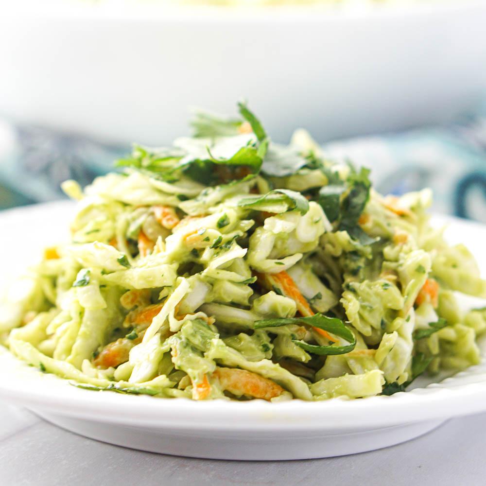 closeup of a white plate with keto avocado coleslaw