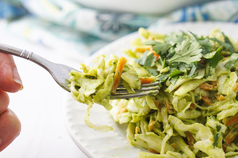a forkful of the creamy avocado keto coleslaw