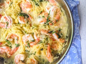 If you are a looking for a wonderful Thai flavored noodle dish, look no further. This coconut basil shrimp spaghetti squash recipe is full of flavor, low carb, gluten free and only takes about 20 minutes to make!