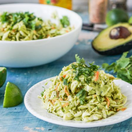 This creamy cilantro lime coleslaw is a delicious low carb side dish that is perfect for summer picnics or to serve alongside tacos or anything on the grill.  This slaw is not only crunchy and cream, but th lime and cilantro add so much flavor! . Each serving is only 0.3g net carbs