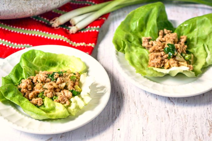 These scallion & ginger chicken lettuce cups are such an easy and healthy recipe that is perfect for the summer weather. Chicken lettuce cups make for a delicious low carb dinner or lunch or even appetizer.  Only 5.4g net carbs per serving.