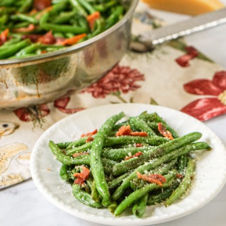 These low carb green beans & bacon are a staple in our household. This is a delicious recipe to keep in mind when those fresh green beans from the garden start rolling in. Best of all it only takes 15 minutes to make!