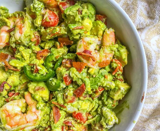 This keto avocado shrimp salad with bacon is so decadent and delicious. It's like guacamole and shrimp got together with a blt, but then there is blue cheese in there too! This delicious keto salad that is low carb too with only 2.1g net carbs per serving.