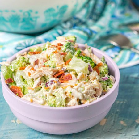 This bacon ranch chicken & broccoli salad is a scrumptious low carb salad that is perfect for a hot summer day or to take to a picnic. Loaded with chicken, bacon, ranch, cheese and the brightness of chopped broccoli to make a filling low carb lunch with 3.7g net carbs per serving.