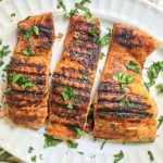 This low carb bbq salmon is easily made indoors and has a creamy garlic herb sauce to top it off. A low carb bbq rub on the salmon is spicy and sweet and the creamy sauce is a cooling compliment to the dish.