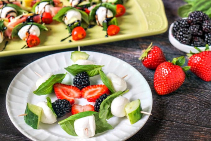 These easy caprese kebabs are a fun and healthy appetizer or even a low carb snack for summer. Using a variety of fruits and vegetables with fresh mozzarella and basil and a drizzle of balsamic glaze for a fresh summer bite.