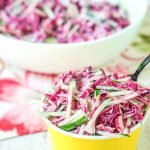 This cucumber slaw with margarita dressing is a delicious low carb salad that would be perfect for your next bbq or picnic. A delicious way to use some of those garden cucumbers! The low carb creamy dressing has the sweet and tart taste of a margarita.