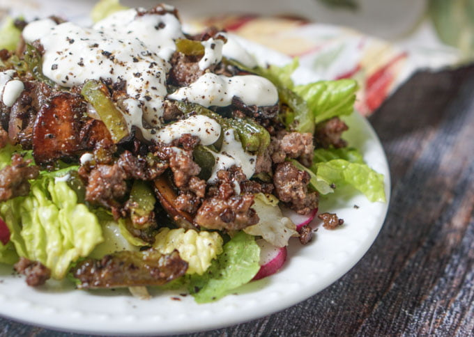 This low carb Philly cheesesteak salad is the answer to your cheesesteak cravings. It's easy to make. The savory meat mixture over crunchy and cool lettuce are topped with a creamy Parmesan dressing. Only 5.3g per serving.