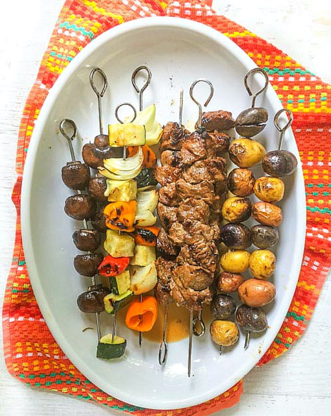 This marinated steak kebabs dinner is the perfect low carb dinner for a summer night. Marinate the steak in the morning, skewer and grill later so your whole dinner is cooked on the grill.