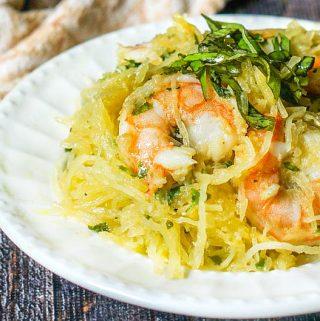 white plate with basil & Shrimp spaghetti squash