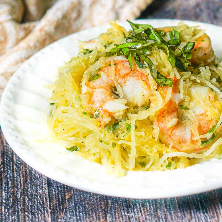 white plate with basil & Shrimp spaghetti squash