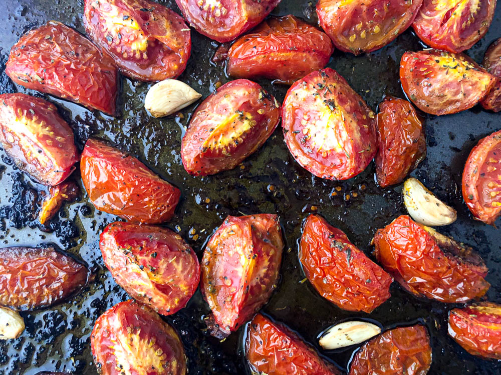roasted tomatoes and garlic on a cookie sheet