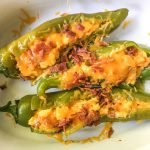 These low carb buffalo breakfast hatch chile peppers make for a delicious change from your standard eggs and bacon. A bit of spice along with cheese, chiles and bacon and you've got a low carb breakfast you can eat with your hands! Only 4.6g net carbs!