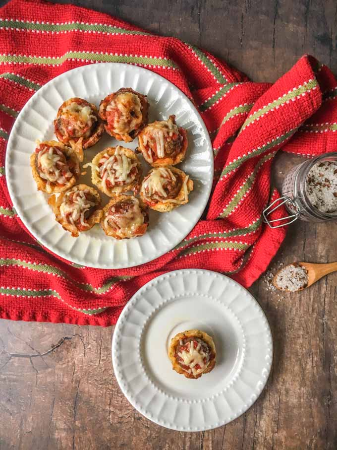 These low carb meatball sub cups are perfect finger food for your next football party. Each gluten free cup is like a mini meatball sub with a tasty bread cup, marinara sauce, meatballs and cheese. Only 2.4g net carbs per cup.