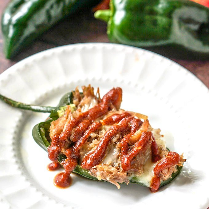 These bbq pulled pork stuffed poblanos work as a low carb appetizer, snack or even dinner. The poblanos have bit of heat, while the bbq pork has sweetness and spice and the cheddar cheese pulls it all together.  Only 4.3g net carbs per stuffed pepper.