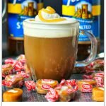 salted caramel cream coffee drink with text overlay and caramel cream candies scattered and Torani bottles in background