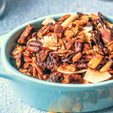 This samoa cookie flavored gluten free granola is a delicious and healthy snack or low carb breakfast! Eat it as is or as low carb breakfast cereal and it's only 3.2g net carbs per serving!