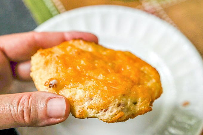 hand holding bacon cheddar scones