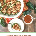 baking dish with bbq pulled pork stuffed poblanos with text overlay