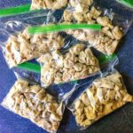 ziplock baggies with cooked chicken cubes for freezing with text