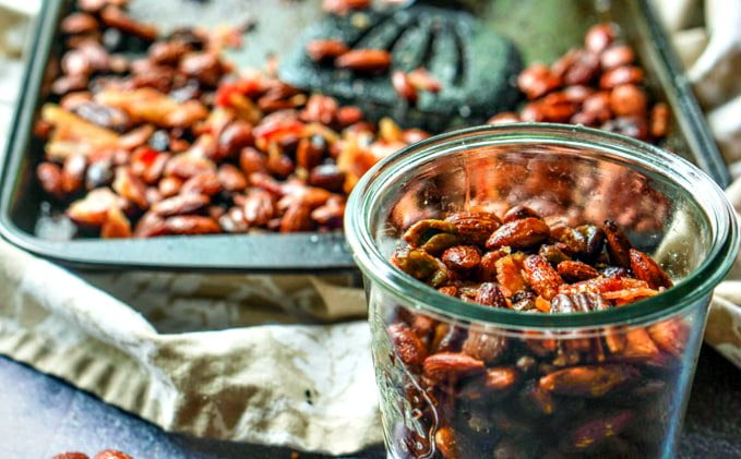 If you are looking for a new low carb snack, try this maple bacon roasted nut mix. Bits of bacon scattered among roasted nuts that are flavored with maple make the perfect salty, sweet snack.