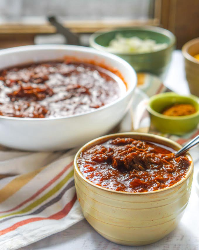 This easy shredded beef chili in the Instant Pot recipe is not only super tasty but very versatile. Eat like you would a bowl of chili or use for quesadillas or burritos. Also tastes great over rice or cauliflower rice. Only 7.1g net carbs and you can also make it in the slow cooker.