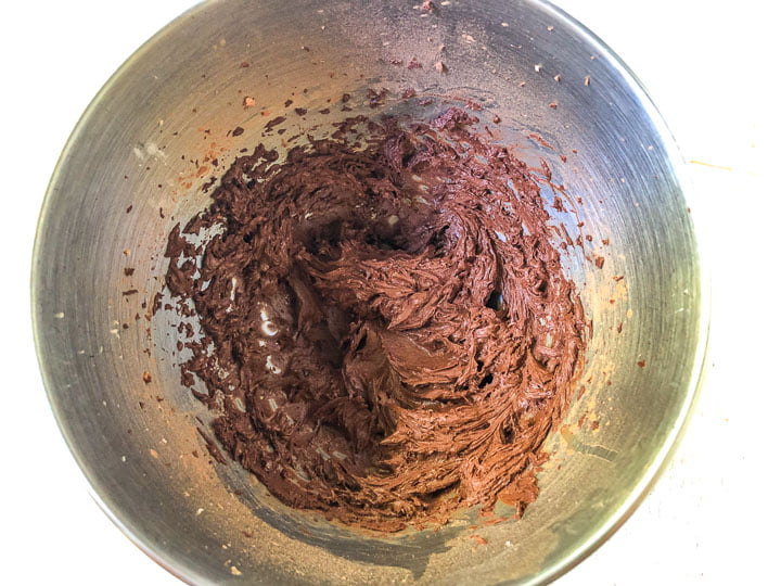 mixing bowl with chocolate brownie cookie batter