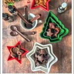 christmas shaped ramekins with keto chocolate candy with text overlay