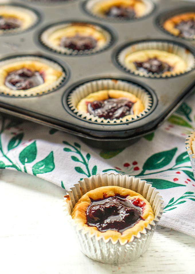 These low carb cheesecake tarts are topped with a sweet and tart blueberry sauce and are perfect for the holiday season. With a few ingredients you can easily make these tasty bite size treats to take to a party or to have on hand for yourself.