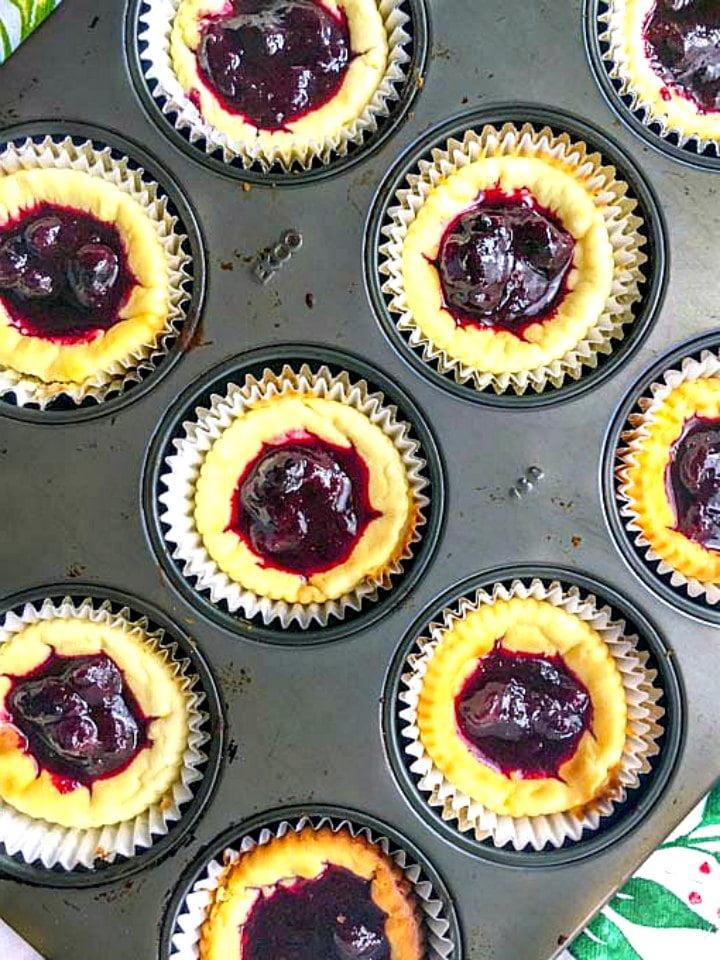 aerial view of mini blueberry cheesecake tarts