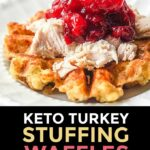 closeup of keto stuffing waffles topped with leftover turkey and cranberry sauce