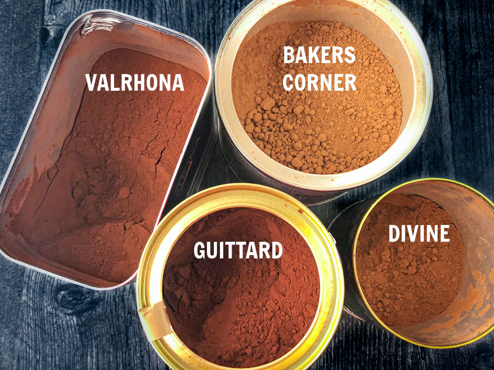 4 cocoa powders with the lids off and text overlays showing the names of each